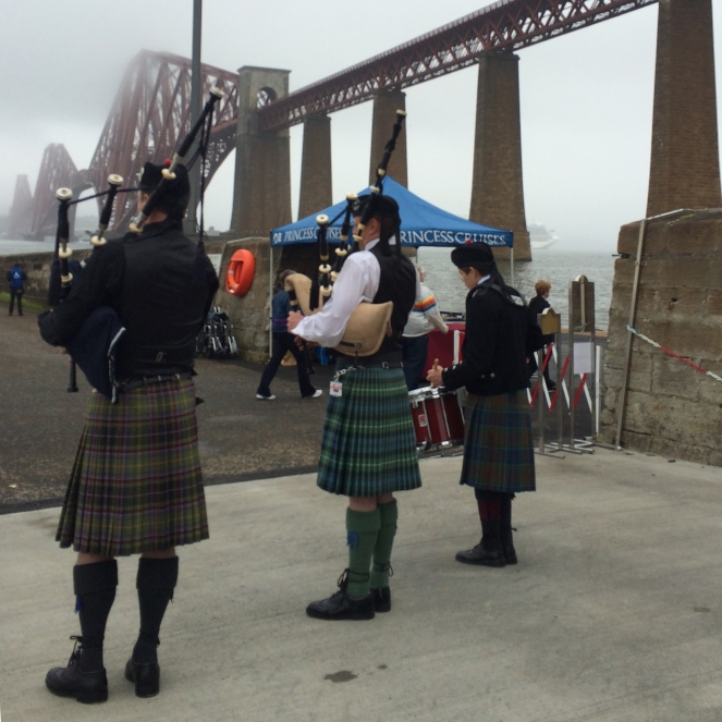 A lovely welcome: pipes, drum, and kilted Scotsmen.
